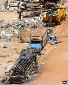 "Destroyed trucks in the abandoned ""conflict zone"" where Tamil Tigers separatists made their last stand"