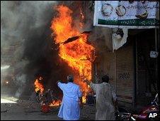 Shops burn in Peshawar, Pakistan