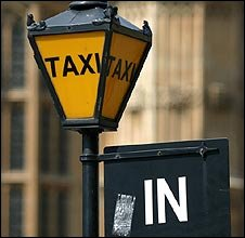 Taxi sign at Westminster