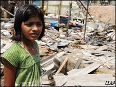 Rubina Ali stands in front of her demolished shanty in Mumbai
