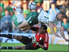 Leon Best collides with Nigeria keeper Austin Ejide early in the game