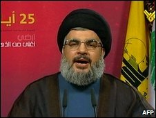Hassan Nasrallah giving TV speech.