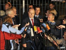 Peer Steinbrueck (centre) talks to reporters