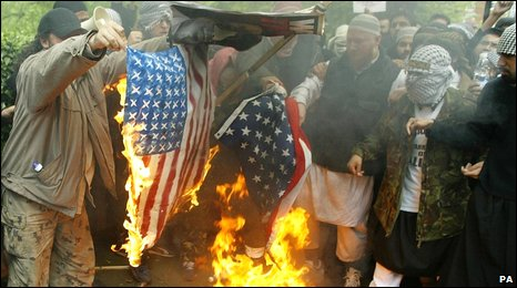 Muslim demonstrators burn a US flag (library image)