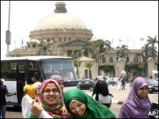 Students in front of Cairo university, where President Obama is to speak