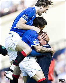 Rangers assistant Ally McCoist joins in the celebrations