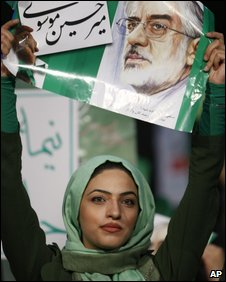 Female supporter waves poster of Mir-Hossein Mousavi
