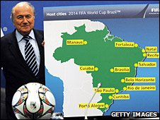 Fifa president Sepp Blatter and the 12 host cities