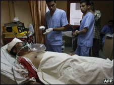 Palestinian medics treat a wounded man at the emergency ward of a hospital in Nablus