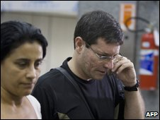 A relative of a passenger aboard the plane speaks into a mobile phone at Rio airport, 1 June