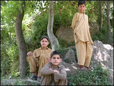 Sanaullah (sitting behind), his brother (front) and a neighbour boy (standing)