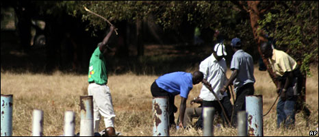 Zanu-PF supporters assaulting an opposition supporter last year