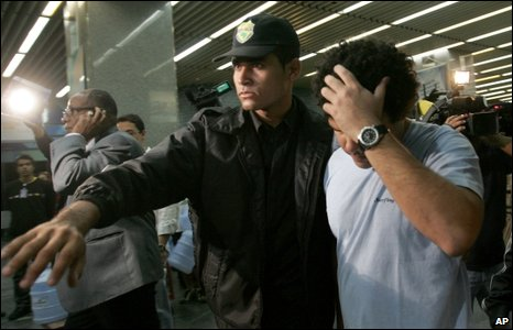 Staff at Rio's international airport lead away a man seeking information on the missing flight, 1 June