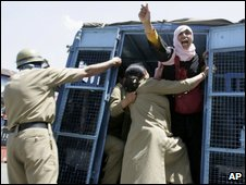 Woman arrested during a protest in Indian-administered Kashmir