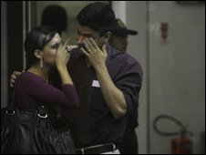 Relatives of missing passengers weep at Rio's Jobim airport, 1 May