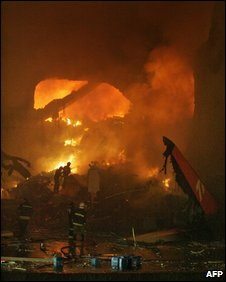 Firefighters tackle a blaze after the Tam air crash in at Congonhas airport, Sao Paulo, 17 July 2007