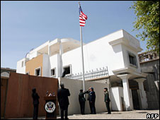A flag flies outside the US embassy in Tripoli, Libya