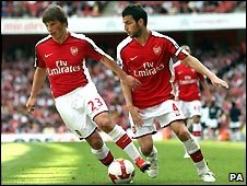 Arsenal's Andrey Arshavin (left) takes the ball off team mate Cesc Fabregas