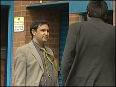 Yorkshire College principal Mohammed Faisal, on the left, being watched by the BBC, outside a restaurant in Glasgow