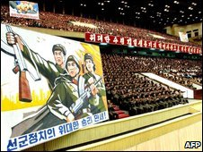 N Korean military officers celebrate the nuclear test at Pyongyang Indoor Stadium on 26 May (KCNA)
