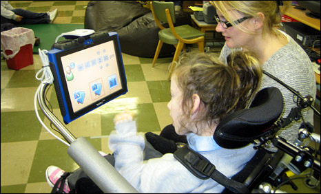 Child with cerebral palsy with a classroom assistant