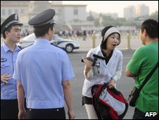 A Chinese police questions a Japanese journalist trying to enter Tiananmen Square on June 4, 2009.