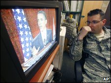US serviceman watches the president's speech in Afghanistan
