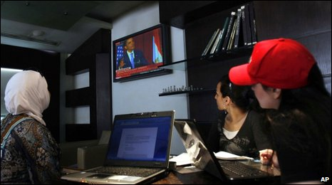 Syrian women listen to the speech of US President Barack Obama at a cafe in downtown Damascus