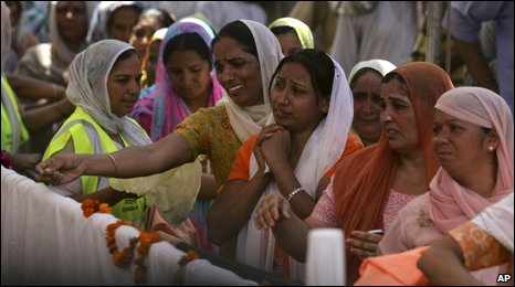 Women mourn as they pay their last respects to Sant Ramanand in Jalandhar, in the northern Indian state of Punjab, Thursday, June 4, 2009