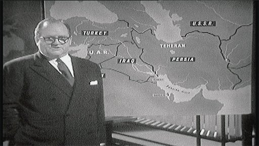 Richard Dimbleby in front of map of Iran 1961