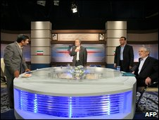 Ahmadinejad (left) and Mousavi (right) get ready for a live debate, 3 June, 2009
