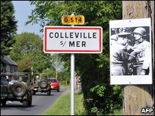 A picture showing US President Dwight Eisenhower is stuck to a tree in Colleville sur Mer, Normandy, amid preparations for the 65th anniversary of D-Day, 4 June 2009