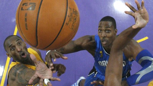 Kobe Bryant goes for the ball with Dwight Howard 