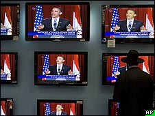 "An ultra-Orthodox Jew watches President Barack Obama""s speech on television screens at a shopping center in Jerusalem"