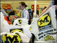A Morrisons employee at a till in a store