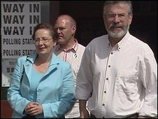 Sinn F�in President Gerry Adams accompanies Bairbre de Br�n as she votes in West Belfast.