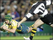 Josh Lewsey is powerless to stop Matt Giteau scoring Australia's third try