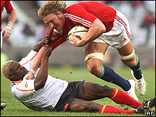 Lions number eight Andy Powell struggles to escape the Cheetahs defence