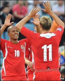 Rob Earnshaw congratulates Wales goal-scorer Dave Edwards