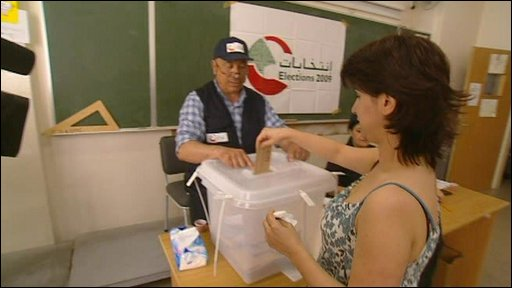 Voter places ballot in Lebanon&amp;apos;s parliamentary elections