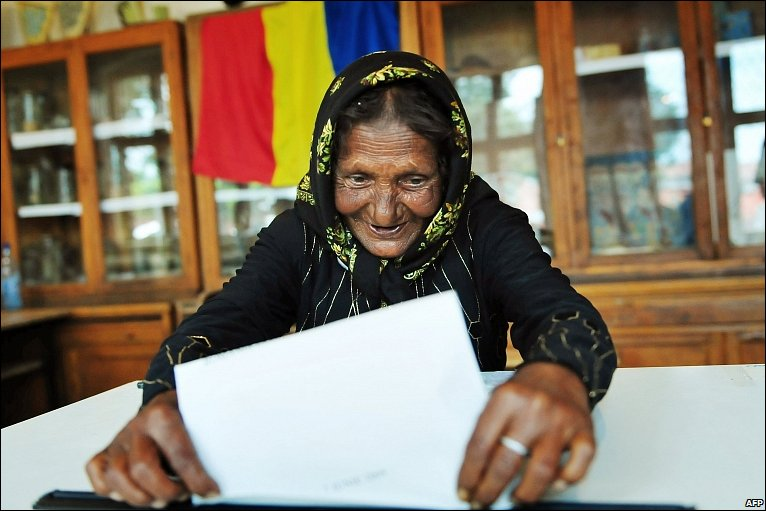 A woman votes in EU elections