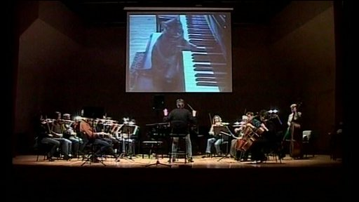 Nora, the piano-playing cat accompanied by an orchestra