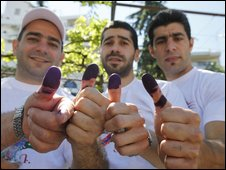Lebanese voters show their ink-stained fingers after casting their ballots in Bikfaya town