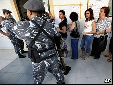 Women queue to vote in Achrafiyeh as soldiers stand guard