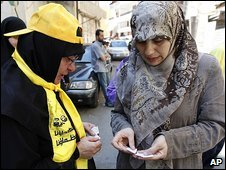 A Hezbollah activist distributes ballot papers in Beirut