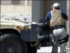 A contractors of the US private security firm Blackwater securing the site of a bomb attack in central Baghdad (2005)
