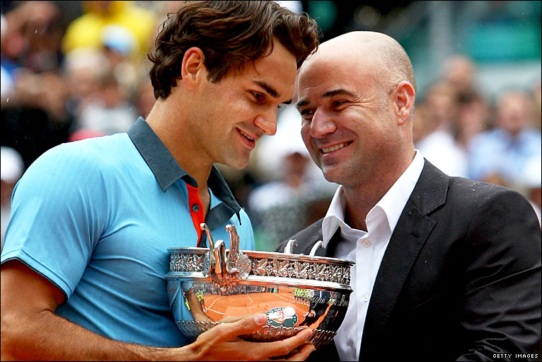 Finally clay is conquered by Roger Federer, Agassi presents him the trophy