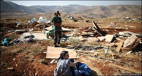 Residents of Maoz Ester after it was demolished on 3 June 2009
