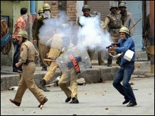 Police fire teargas shells towards Kashmiri Muslim protestors during a protest in Srinagar on June 7, 2009.