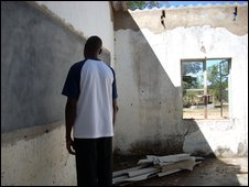 Teacher in derelict buildings of a school in Zimbabwe